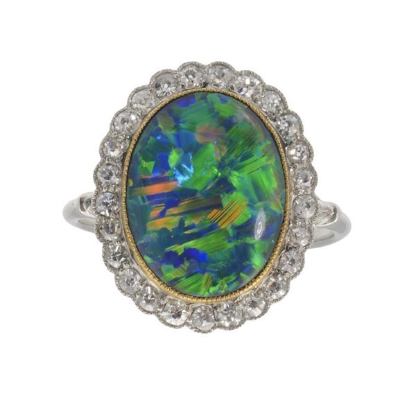 A BLACK OPAL AND DIAMOND CLUSTER RING Image